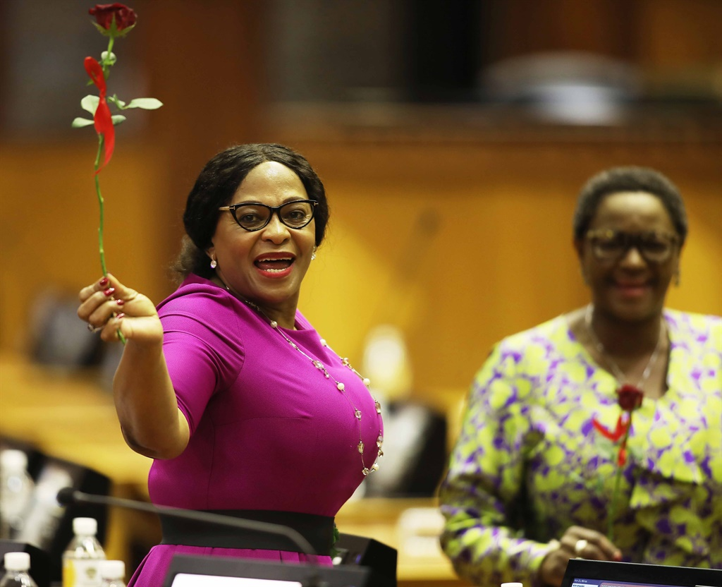 Environmental Affairs minister Nomvula Mokonyane shares a Valentine's moment during President Cyril Ramaphosa's State of the Nation Address (SONA) 2019 debate reply at the National Assembly on February 14, 2019. (Photo by Gallo Images / Sowetan / Esa Alexander)