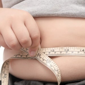 fat child check out his body fat with measuring ta