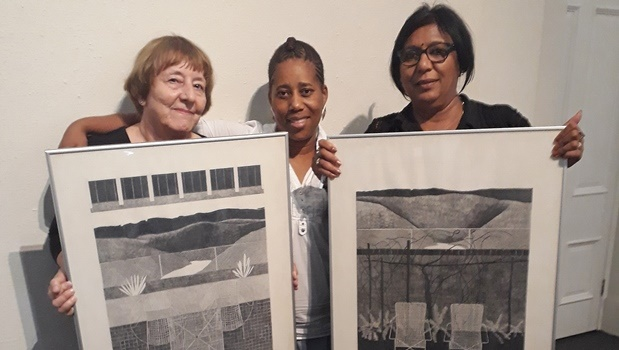Kobie Venter, Pinkie Mitshali and Reena Bhoodram are pictured with the two rare pencil drawings by Walter Oltmann.