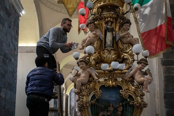 CATANIA, ITALY - FEBRUARY 05: Two men at work on a