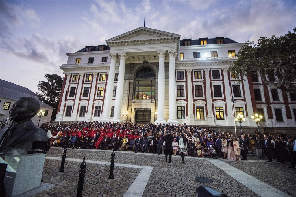Newly sworn in members of Parliament pose for a photograph outside the South African Parliament in Cape Town. (Rodger Bosch, AFP, file)