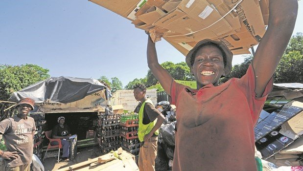 Simphiwe Mnguni (32) from KwaPata waits for his cardboards to be weighed at recycling depot in Pietermaritz Street.