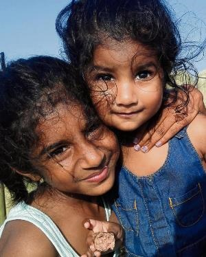 Kayley (8) and Kassidy Reddy (2) from Mooi River spent their day with family at Durban's beachfront.
