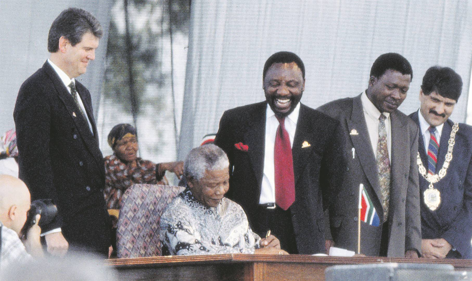 Nelson Mandela and Cyril Ramaphosa at the signing of the Constitution on 10 December 1996. (Media24)