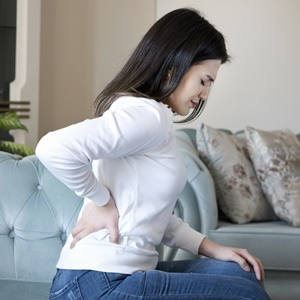 Young woman with back pain