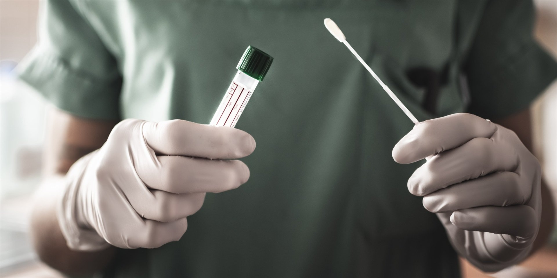A nurse with a swab for a coronavirus test.