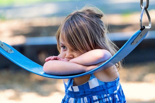 autistic girl on swing