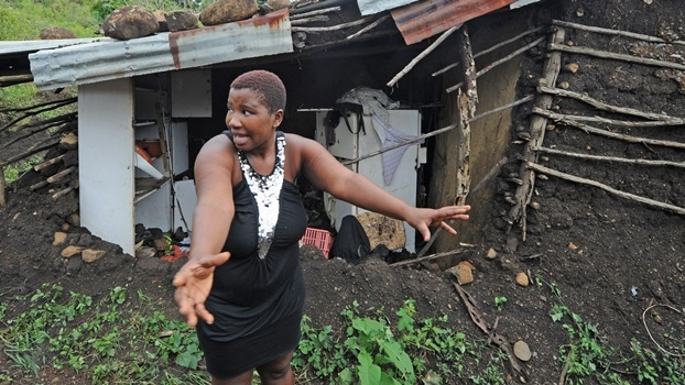Londeka Zondi of Nhlazatshe (near Edendale) stands next to her home, completely ravaged by flash flooding during Wednesday night's storm. Zondi is among hundreds of people from around Pietermaritzburg who suffered the devastating effects of the storm.
