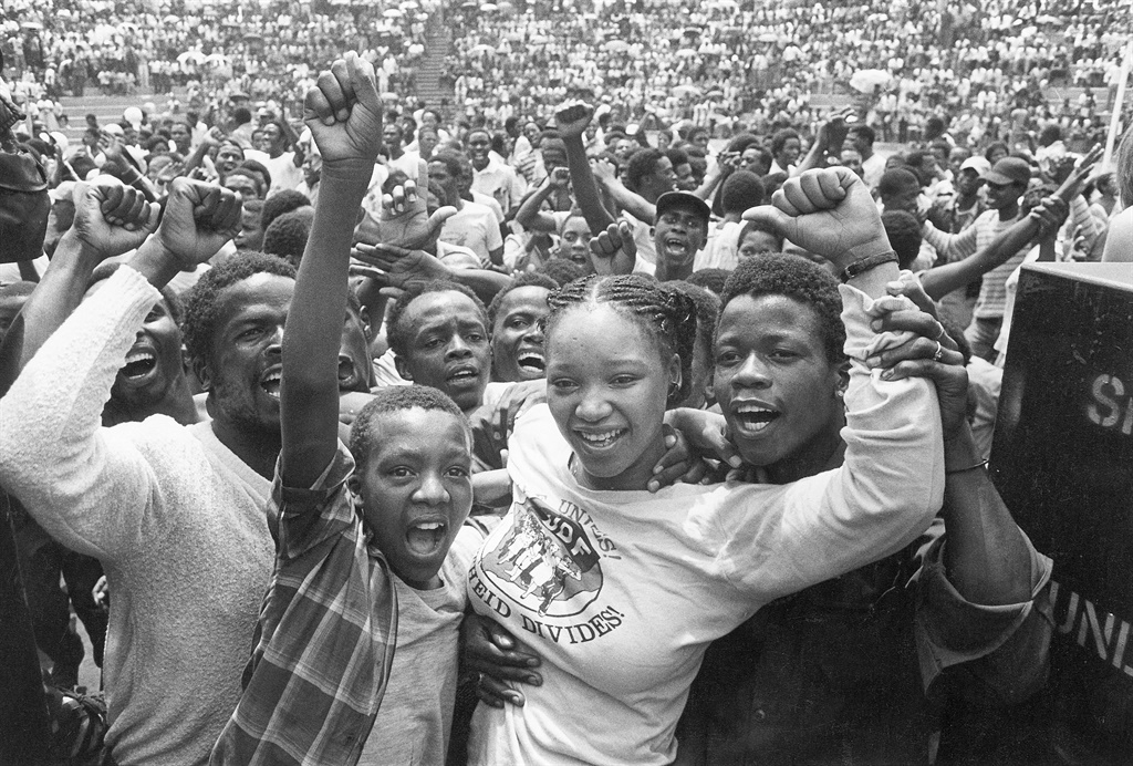 """Feb. 10, 1985, Nelson Mandela's daughter Zindzi read a letter written by her father during his incarceration to a crowd of his supporters at Jabulani Stadium in Johannesburg. """"Your freedom and mine cannot be separated,"""" he wrote, explaining why he was rejecting an offer for his conditional release from prison.. (Photo by Gallo Images / Rapport archives)"""