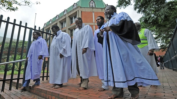 Shembe Chief Mqoqi Ngcobo (2nd left)leaves the high court with pastors of the Ebuhleni faction on Wednesday.