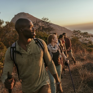 Friends hike in South Africa while the sun sets