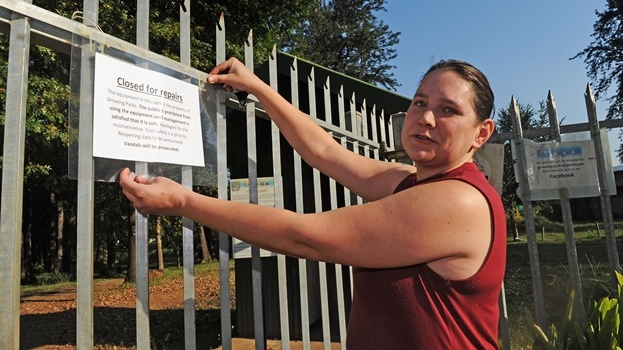 Chase Valley resident Rene Morcom stands at the entrance of Growing Parks which has been closed temporarily for repairs.