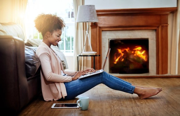 woman sitting in front of fireplace