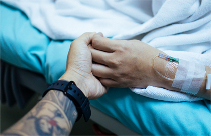 Patient holding hands with friend