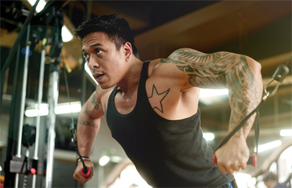 Man with tattoos at gym