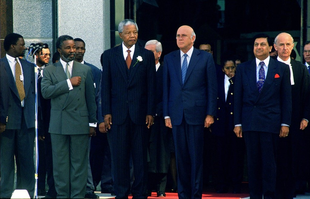 CAPE TOWN, SOUTH AFRICA - May 1994: Newly inaugurated president, Nelson Mandela with his two vice presidents, Thabo Mbeki and F.W. de Klerk at the opening of the first democratically elected parliament. (Photo by Gallo Images/Rodger Bosch)