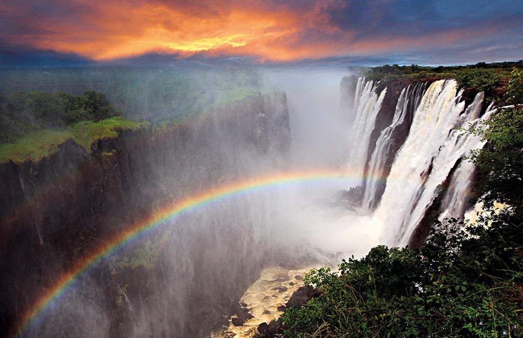 Victoria Falls sunset with rainbow, Zambia; Shutte
