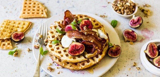 beautfiul buttermilk waffles topped with bacon on