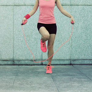 a woman skipping rope