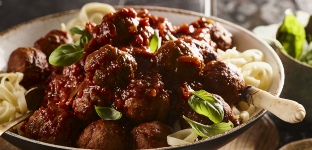Succulent tomato sauce infused meatballs with past