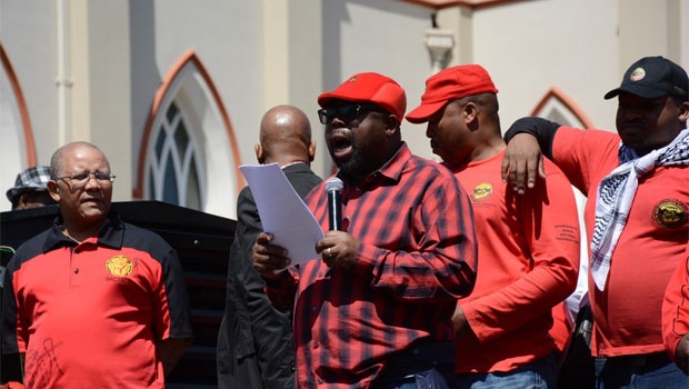 Thulis Nxesi with SACP addresses the marchers in front of Parliament. <br />