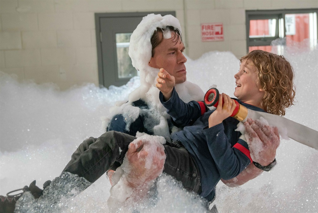 John Cena plays straight-laced fire superintendent Jake Carson in the hilarious new film, Playing With Fire.