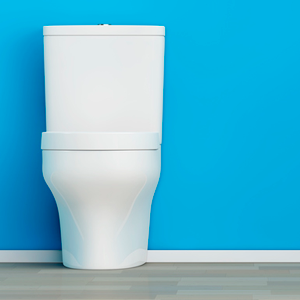 Toilet against blue background