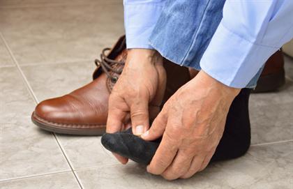 man rubbing foot