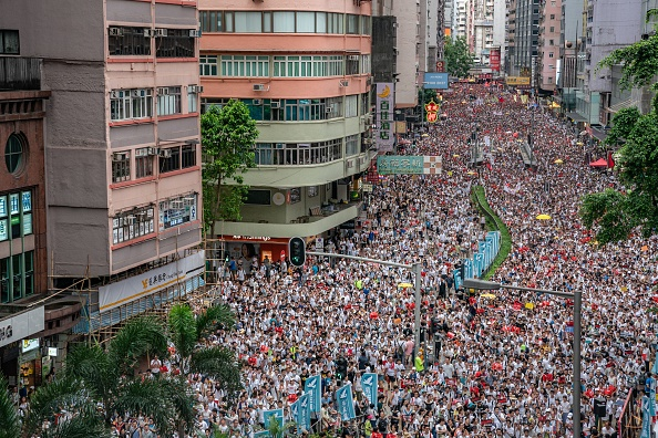 HONG KONG - JUNE 09:  Protesters march on a street