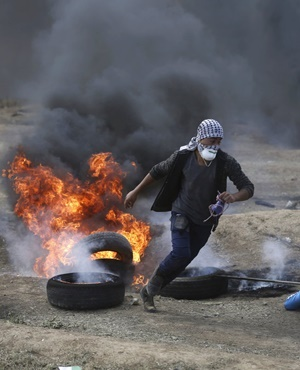 Thousands of Palestinians are protesting near Gaza's border with Israel, as Israel prepared for the festive inauguration of a new US Embassy in contested Jerusalem. (Khalil Hamra, AP)