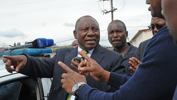 "ANC president Cyril Ramaphosa points out to the scene where ANC activist Musawenkosi ""Qashana"" Mchunu was shot on Friday. Ramaphosa visited Mchunu's family on Monday."