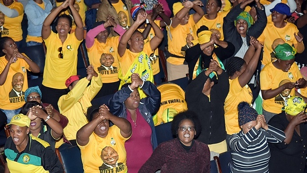 "ANC members sing and dance at the memorial service of the Msawenkosi ""Qashana"" at the city hall on Thursday."