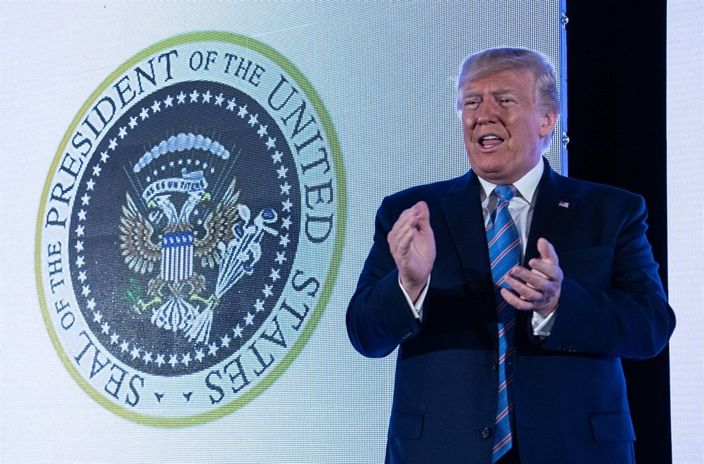 Washington politics watchers did a double take at pictures showing Donald Trump in front of a presidential seal manipulated to make the eagle resemble Russia's two-headed version. (Nicholas Kamm, AFP)