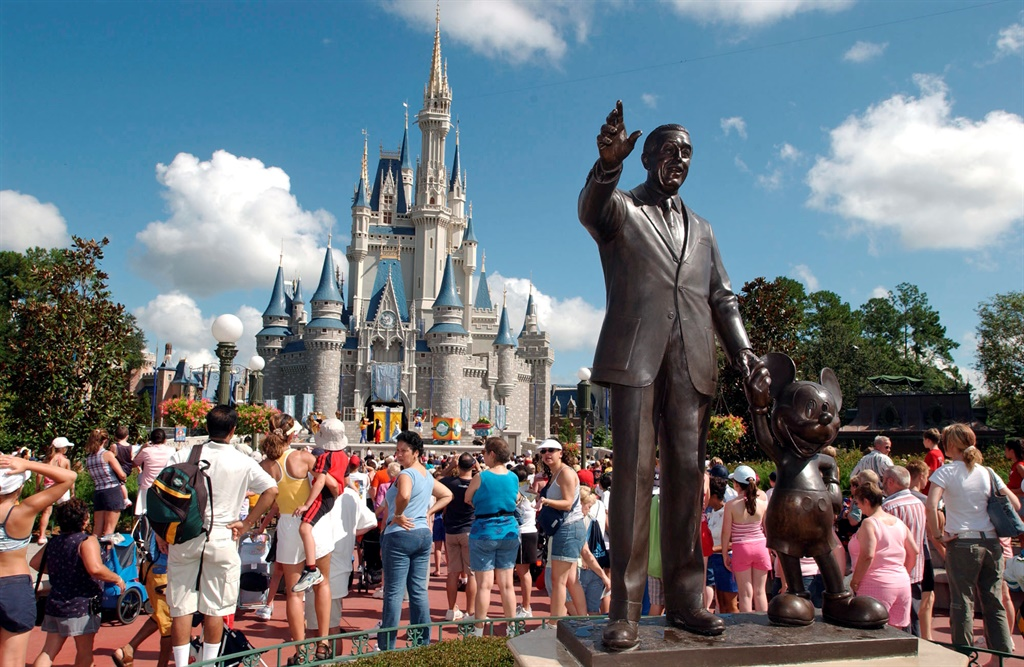 a view of disneyland with a statue of walt disney
