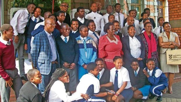 Deputy minister Rejoice Mabudafhasi with the PMB pupils who were presented with certificates at City Hall.
