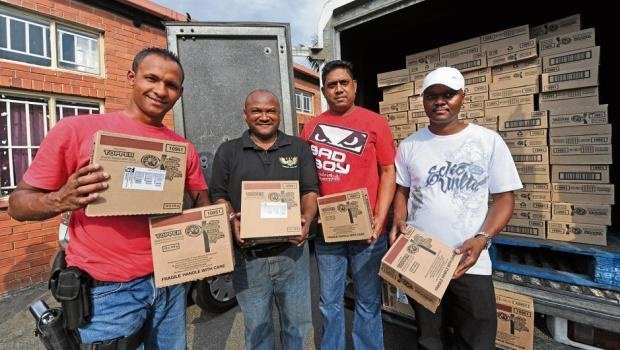 Constable Kyle Coetze, Warrant Officer Ravi Pather, Warrant Officer Ashok Baldawo and Sergeant Chris Khanyile with some of the recovered stolen goods at Mountain Rise police station.