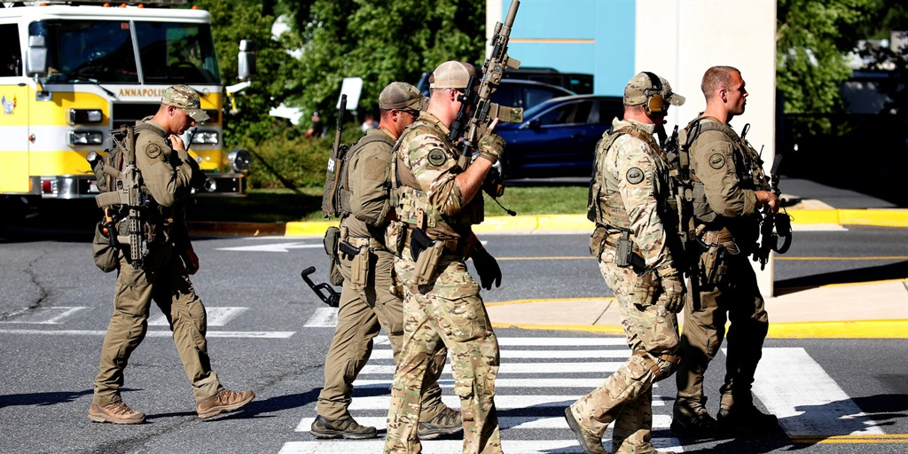Special tactical police gather after a gunman opened fire at the Capital Gazette newspaper, killing at least five people and injuring several others in Annapolis, Maryland, June 28, 2018. (File, AP)