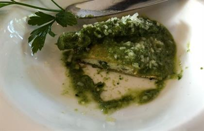serving of agnolotti filled with spinach and aspar