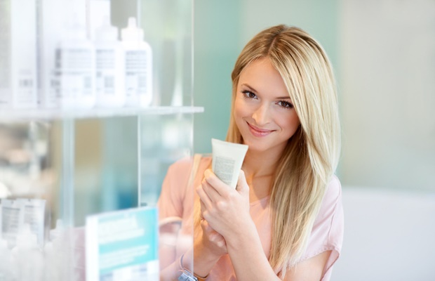 woman reading skincare label