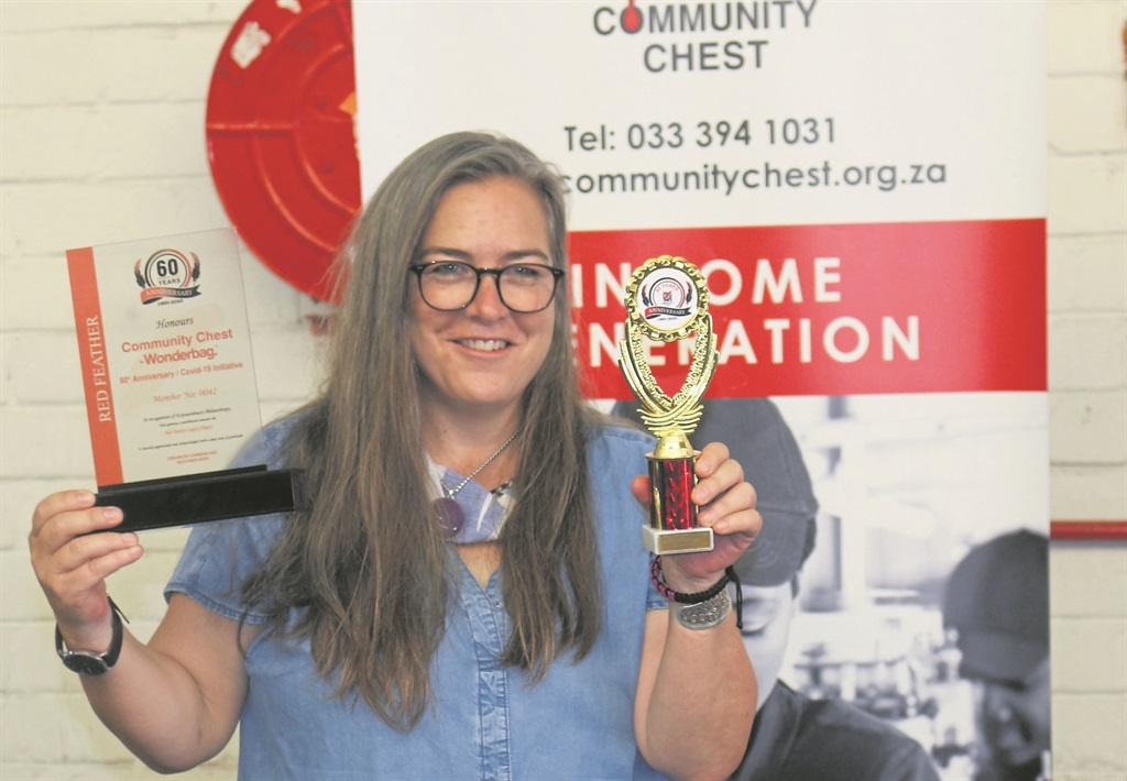 Wonderbag chief executive officer Sarah Collins shows off her Red Feather Legacy certificate and Top Donor Award.