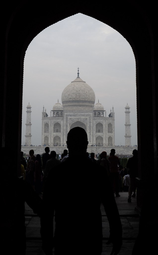Tourists visit the Taj Mahal in smoggy conditions