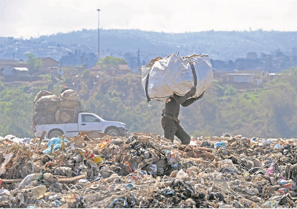 A waste picker at work at the City New England Road landfill site. A proposal to extend the life of the dump would formalise the separation of recyclables.