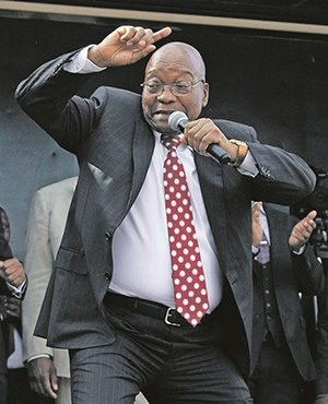 Former president Jacob Zuma dances after appearing in the Durban High Court on Friday. He again declared his innocence and threatened his accusers in a speech to his supporters. PHOTO: AP