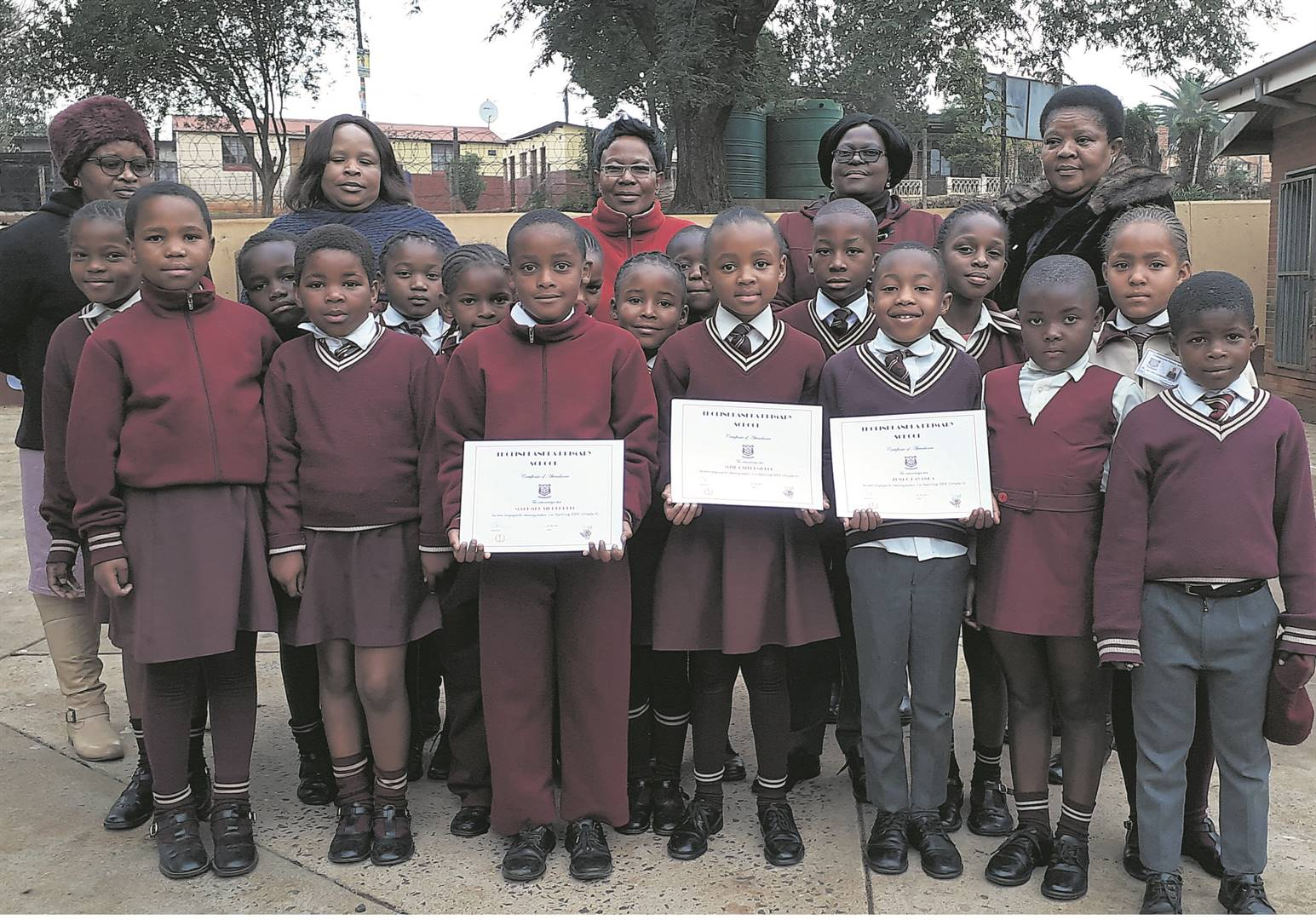 photo: suppliedTeachers from Tholinhlanhla Primary Schoool (back, from left) N.W. Luthuli, B.M.Z. Mthembu, N.P. Hlatshwayo, L.B. Mkhize and N.R. Ndlovu, with pupils who took part in the Spelling Bee.
