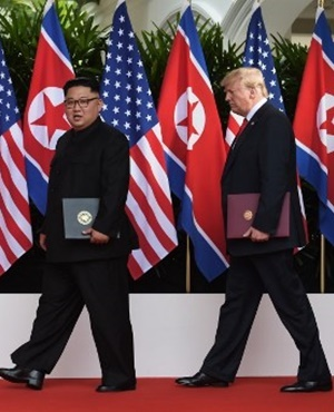 US President Donald Trump (R) walks out with North Korea's leader Kim Jong Un (L) after taking part in a signing ceremony at the end of their historic US-North Korea summit, at the Capella Hotel on Sentosa island in Singapore. (Anthony Wallace, Pool, AFP)