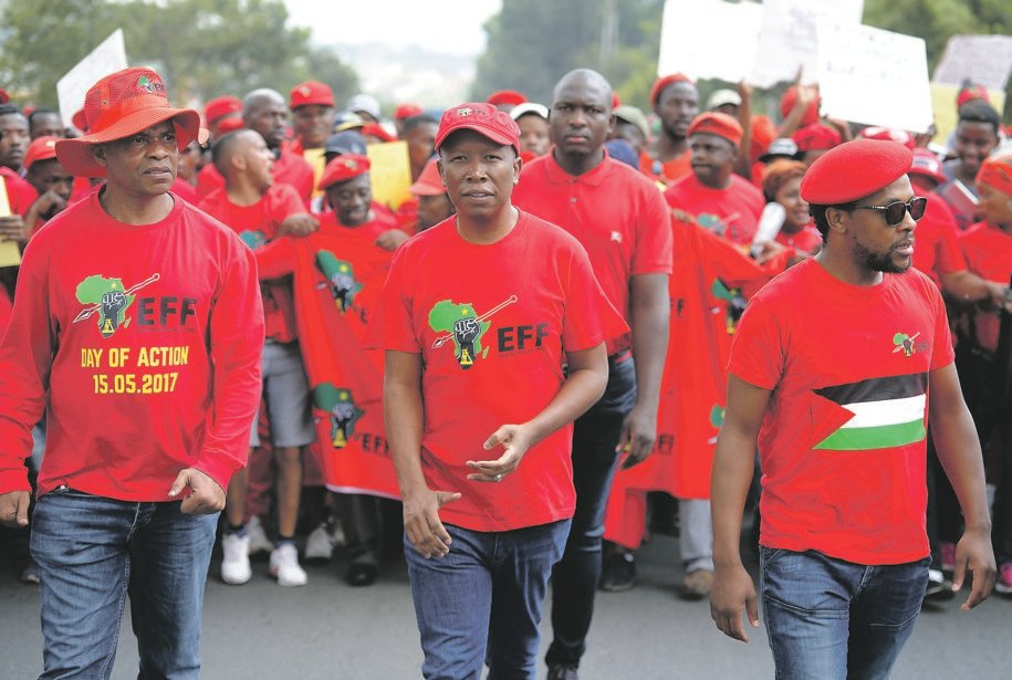 EFF leader Julius Malema (centre) and national spokesperson Mbuyiseni Ndlozi lead party members during a protest march. The EFF is determined to attract a 9 million-strong voter base for next year's elections. Picture: Felix Dlangamandla