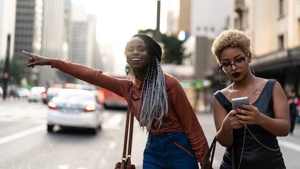 women waiting for uber,hailling cab,