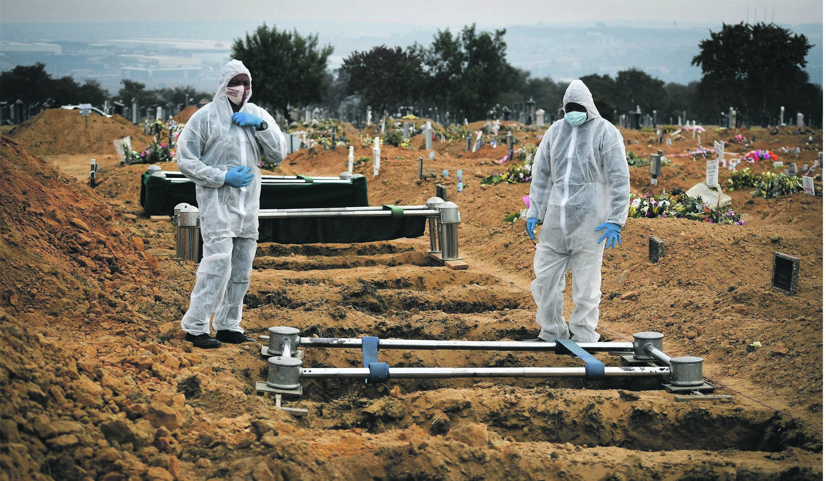 Funeral parlour staff prepare a grave for a victim of Covid-19 at Waterval Cemetery, Johannesburg.