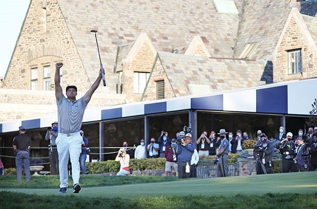 Bryson DeChambeau celebrates on the 18th green after winning the 120th US Open at Winged Foot Golf Club in Mamaroneck, New York on 20 September 2020.