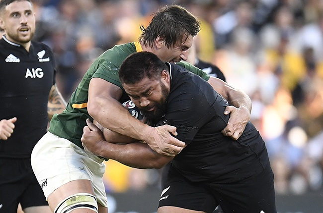 Nepo Laulala of the All Blacks is tackled by Eben Etzebeth of the Springboks (Getty)